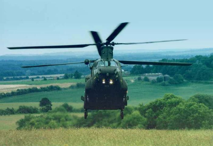 Somewhere in England, A Boeing Chinook stands guard.