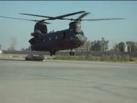View the Video: An unknown CH-47D Chinook helicopter lands with a broken aft landing gear at an unknown location.