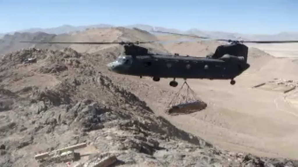 View the Video: An unknown CH-47D Chinook helicopter resupplies a mountain top Observation Post somewhere in eastern Afghanistan.